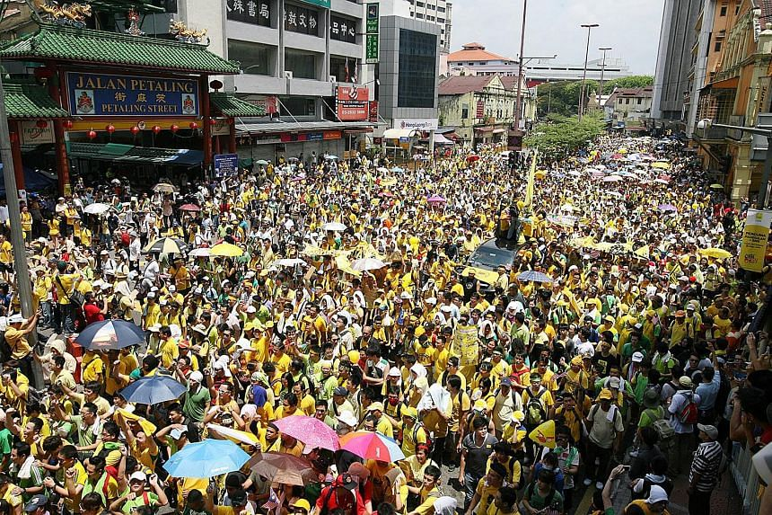 Protesters marching through the streets of Kuala Lumpur during the Bersih rally in this April 28, 2012 file photo.