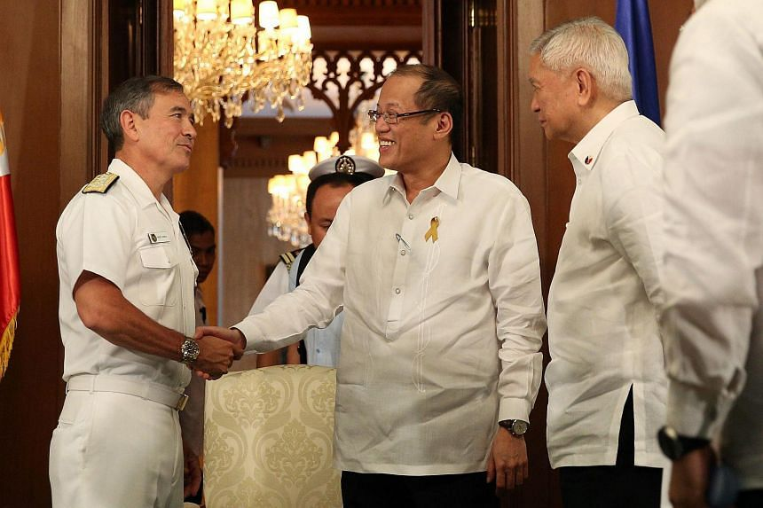 Filipino President Benigno Aquino (centre) and Foreign Secretary Albert Del Rosario (right) greeting Commander of the US Pacific Command Harry B. Harris Jr at the Malacanang presidential palace in Manila on Aug 26, 2015.