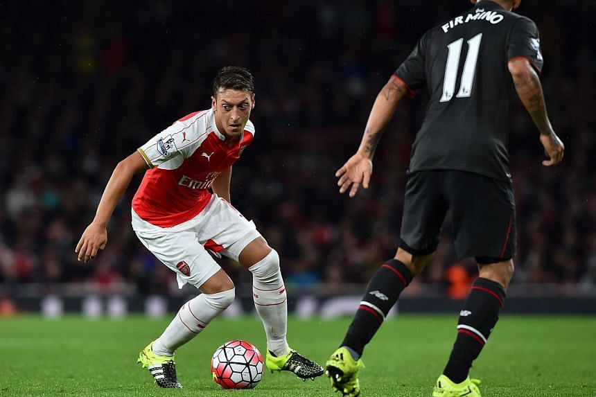 Mesut Ozil (left) controlling the ball during the match between Arsenal and Liverpool on Aug 24, 2015.
