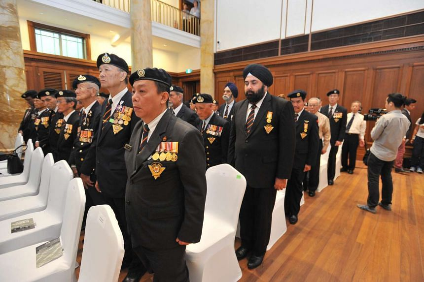 Members of the SAF Veterans League observing a minute of silence inside the City Hall Chamber (now part of the National Gallery Singapore) on Aug 27, 2015.
