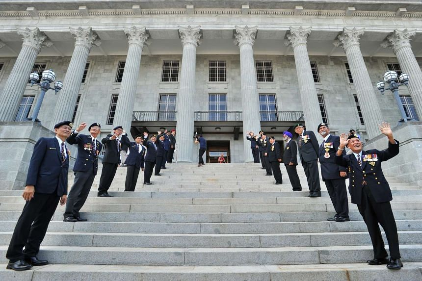 Members of the SAF Veterans League standing on the steps of the National Gallery Singapore, on Aug 27, 2015.