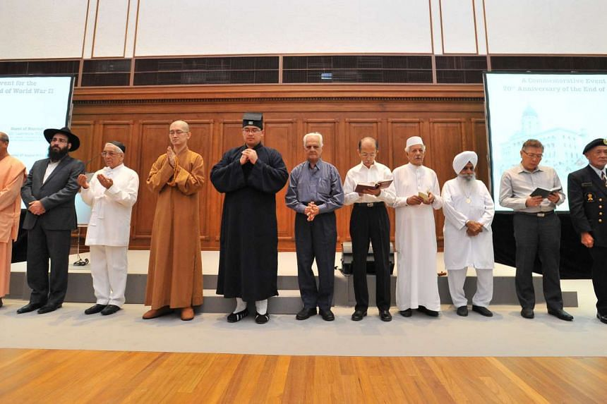 A silent prayer being led by the Inter Religious Organisation (IRO) for peace inside the City Hall Chamber (now part of the National Gallery Singapore) on Aug 27, 2015.