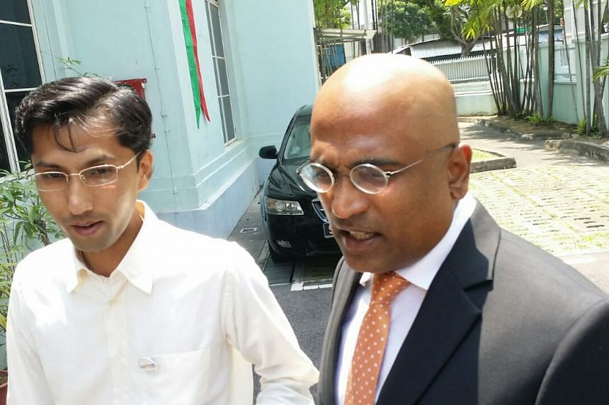 Lawyer M Ravi (right) and Reform Party member Osman Sulaiman speaking to the media outside the Elections Department on Aug 27, 2015.