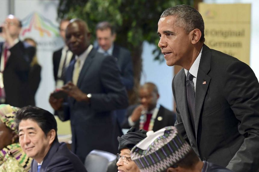 Mr Shinzo Abe, Liberia's President Ellen Johnson Sirleaf, President Barack Obama, Nigerian President Muhammadu Buhari attend the second working session of the G7 summit at the Elmau castle in Kruen, Germany on June 8, 2015.