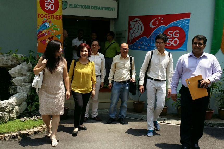 Opposition members (from left) Jeanette Chong-Aruldoss, Lina Chiam, Gilbert Goh, Roy Ngerng and Ravi Philemon leaving the Elections Department on Aug 27, 2015.