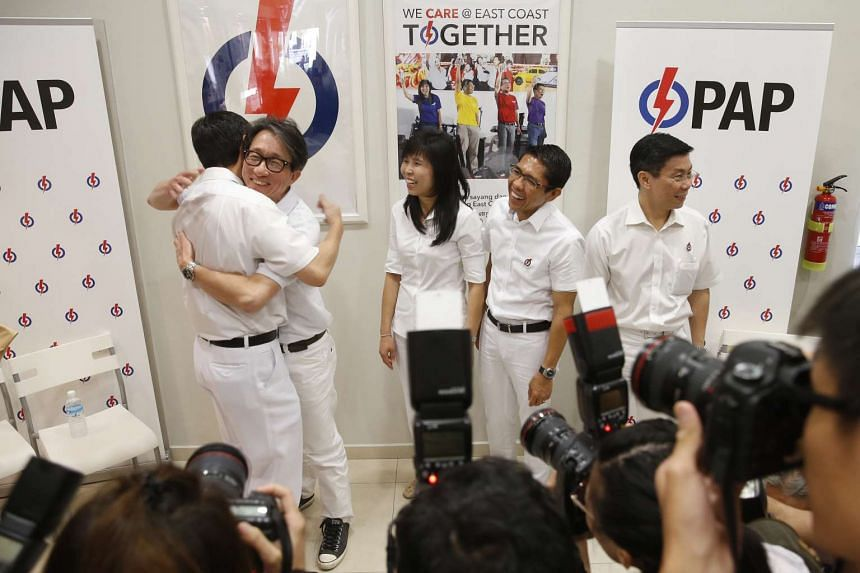 Retiring MP Raymond Lim (left) hugging Mr Lee Swee Say as Ms Jessica Tan, Dr Mohamad Maliki Osman and Mr Lee Yi Shyan look on.