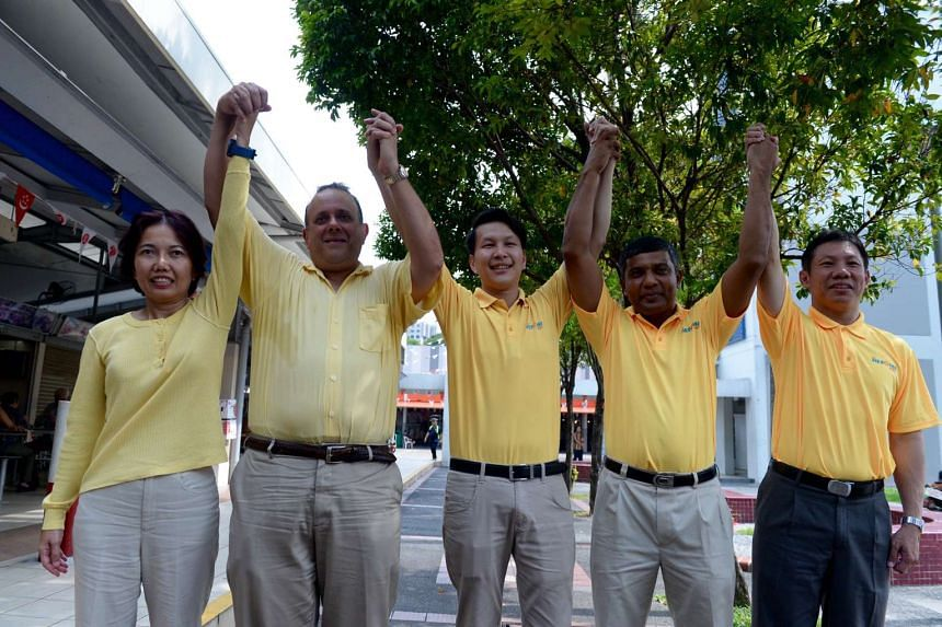 Members of the Reform Party unveiling their candidates at Telok Blangah Food Centre. From left: Madam  Noraini Yunus, Mr Kenneth Jeyaretnam, Mr Andy Zhu, Mr Kumar Appavoo and Mr Darren Soh.