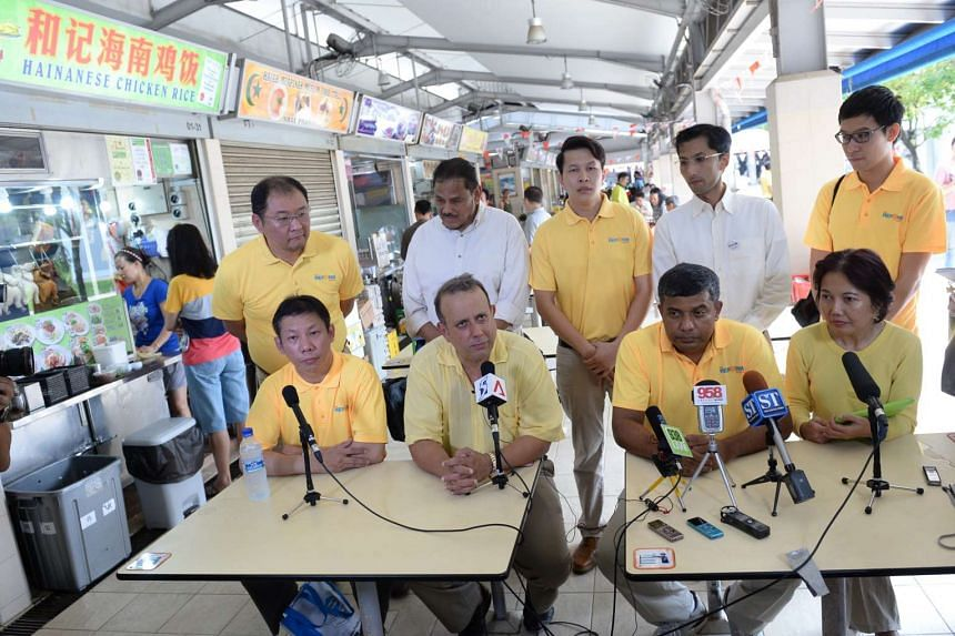 Members of the Reform Party unveiling their candidates at Telok Blangah Food Centre. From left, seated: Mr Darren Soh, Mr Kenneth Jeyaretnam, Mr Kumar Appavoo and Madam Noraini Yunus.