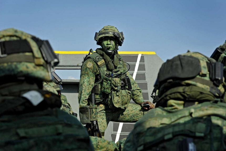 Servicemen from the SAF participating in a military exercise.