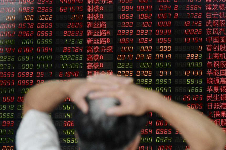 An investor gestures as he checks share prices at a securities firm in Shanghai on Aug 26, 2015.