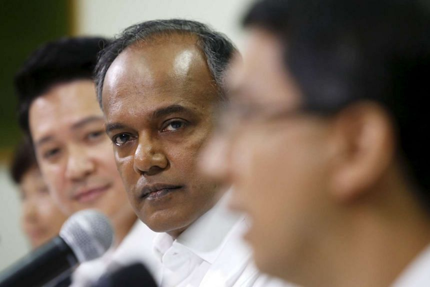 Singapore's Law and Foreign  Minister K Shanmugam (second right) attends a People's Action Party news conference to unveil new candidates ahead of General Election 2015 on Aug 26, 2015.
