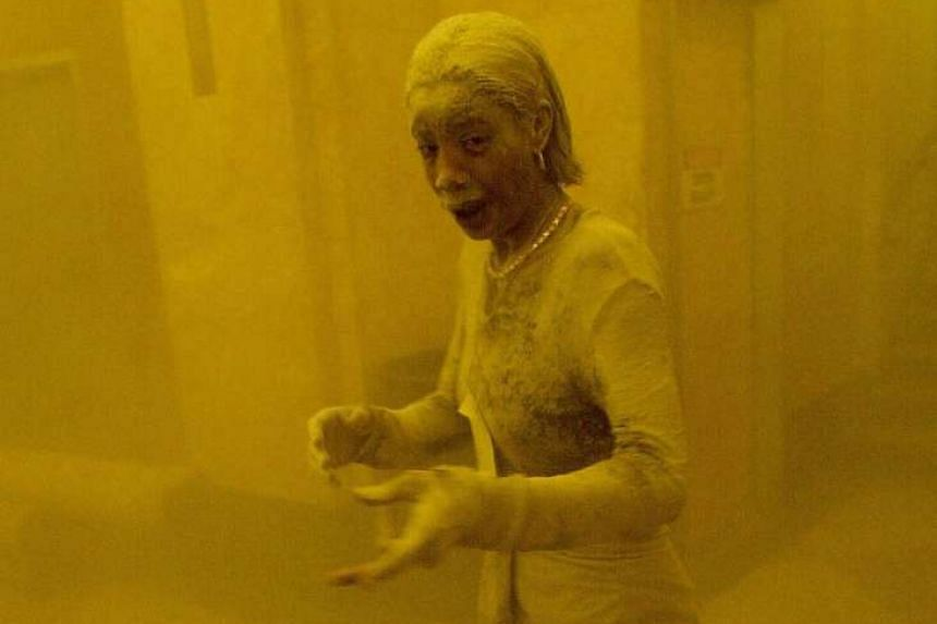 """Marcy Borders became known as the """"dust lady"""" after a photo showed her covered in dust as she escaped the World Trade Center during the 9/11 attacks."""