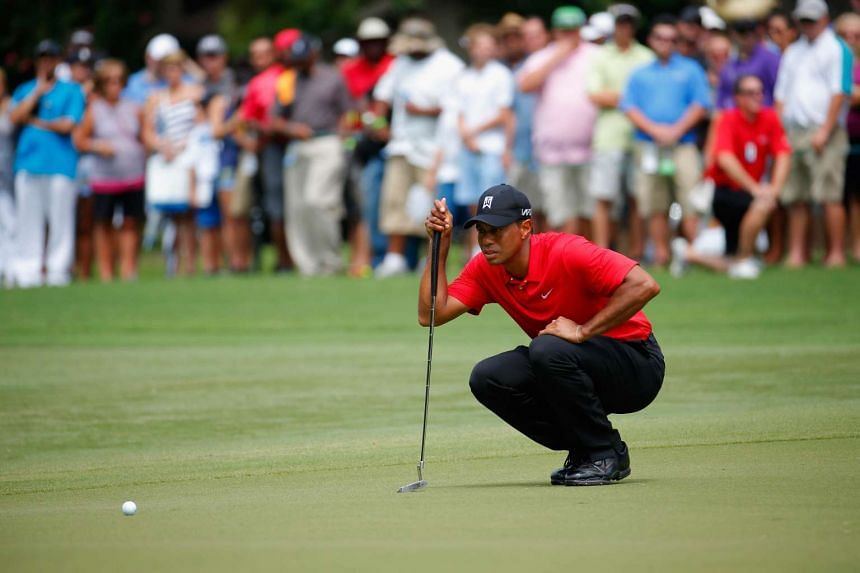 Tiger Woods lining up his birdie putt on the fourth green during the final round of the Wyndham Championship on Aug 23, 2015.
