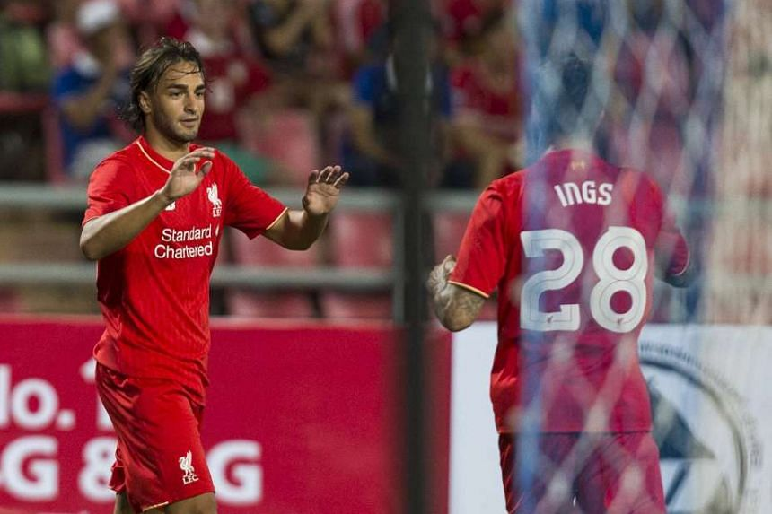Markovic (left) will become the fourth player to leave Anfield this summer should the deal go through,