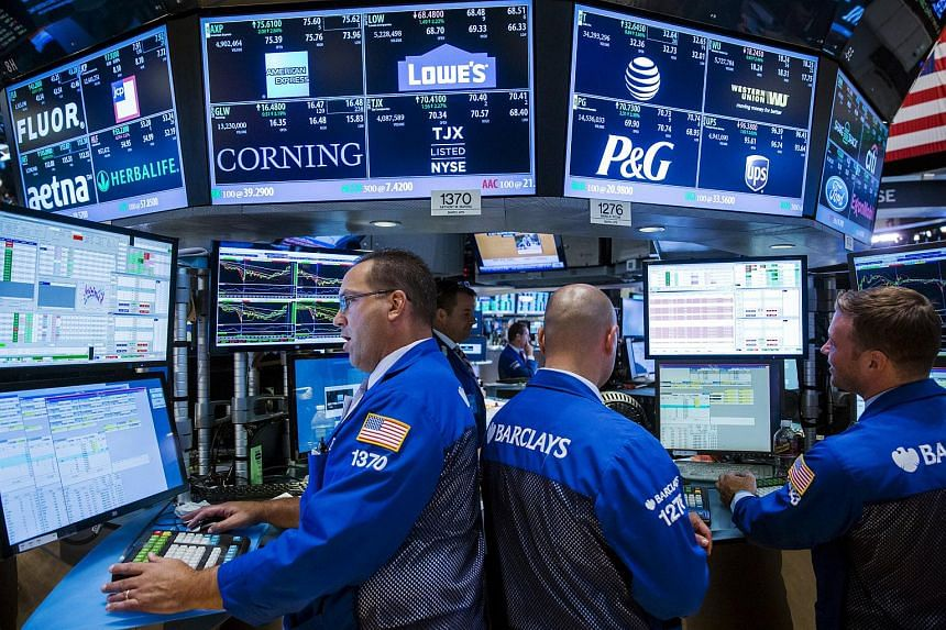 Traders working on the floor of the New York Stock Exchange shortly before the closing bell in New York on Aug 26, 2015.