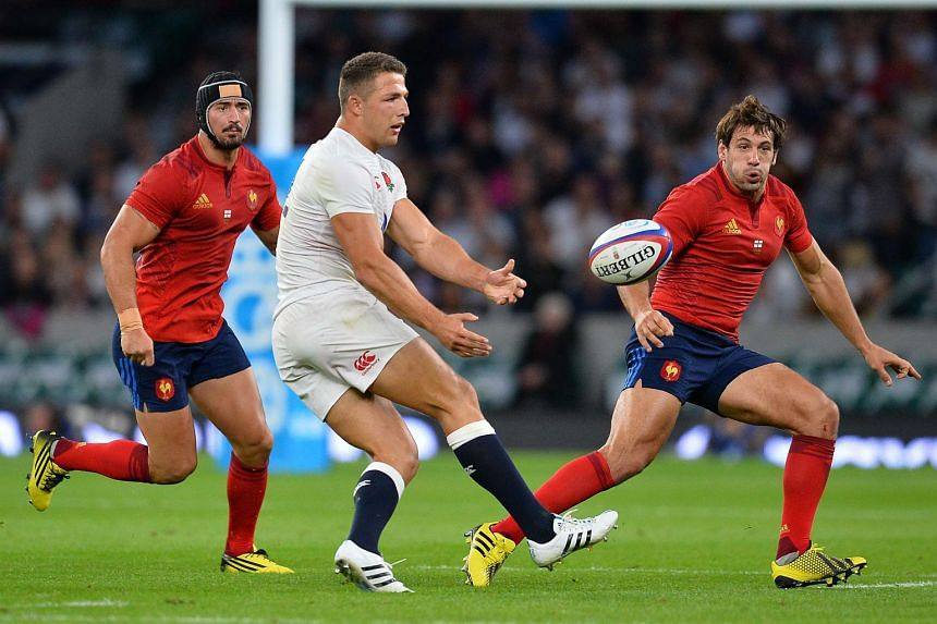 England centre Sam Burgess (centre) passes the ball during a Rugby World Cup warm-up match between England and France at Twickenham Stadium on Aug 15, 2015.