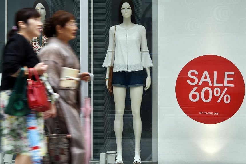 Japan's core consumer inflation stalled and household spending unexpectedly fell, according to latest data.