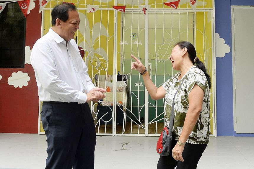 PAP veteran Charles Chong, the newly announced candidate for Punggol East SMC, sharing a joke with Sengkang resident Irene Choo, 63, during a visit to Rivervale Drive yesterday.