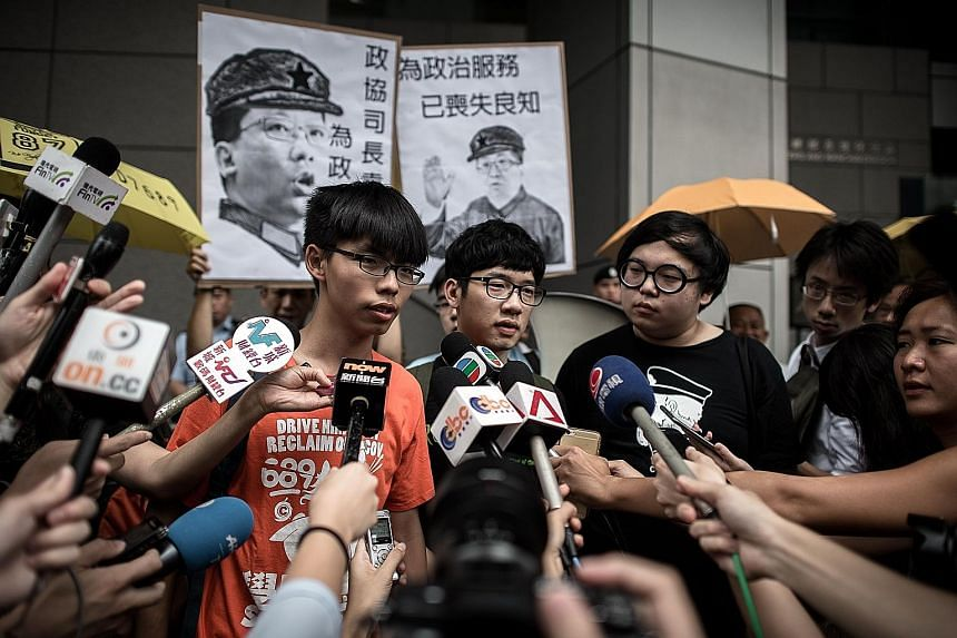 "Hong Kong student leader Joshua Wong (far left) is accusing the authorities of a witch-hunt against those at the forefront of the ""Umbrella Movement"". He is facing several charges for his role in the protests."