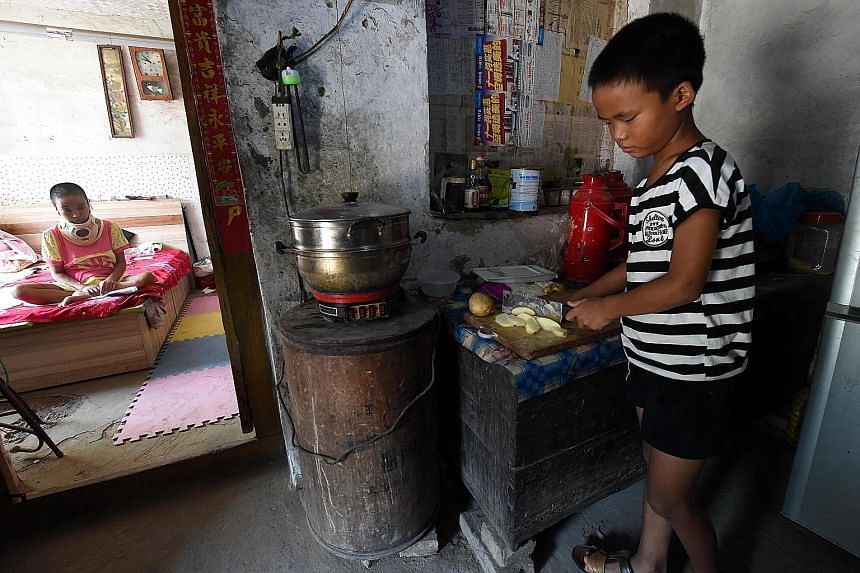 His shoulders may be tiny and his frame small, but Liu Hao, 10, in north China's Hebei province is the rock of his family, caring for his invalid mother, who is estranged from his father. Yesterday, like any other day, the elementary school pupil was