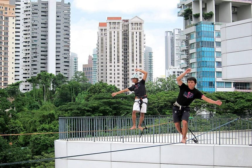 Oyster bar Southbridge (above) on a rooftop in Boat Quay offers a panoramic view of the Singapore River, while the Elephant Slacklines group (left) practises slacklining on the roof of *Scape mall.