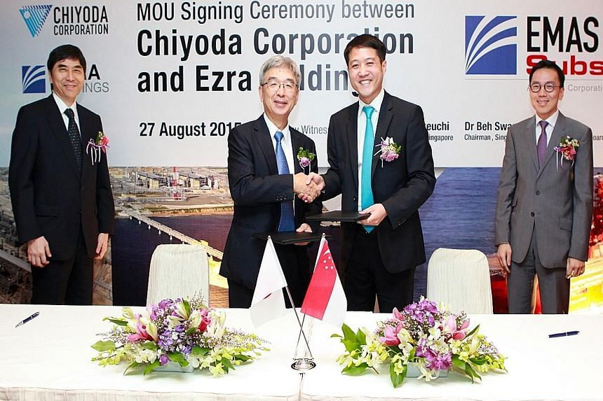 Ezra Holdings group chief executive Lionel Lee (second from right), seals the deal with Chiyoda president and chief executive Shogo Shibuya. They are flanked by Chiyoda's senior executive vice-president Keiichi Nakagaki (far left) and Economic Develo