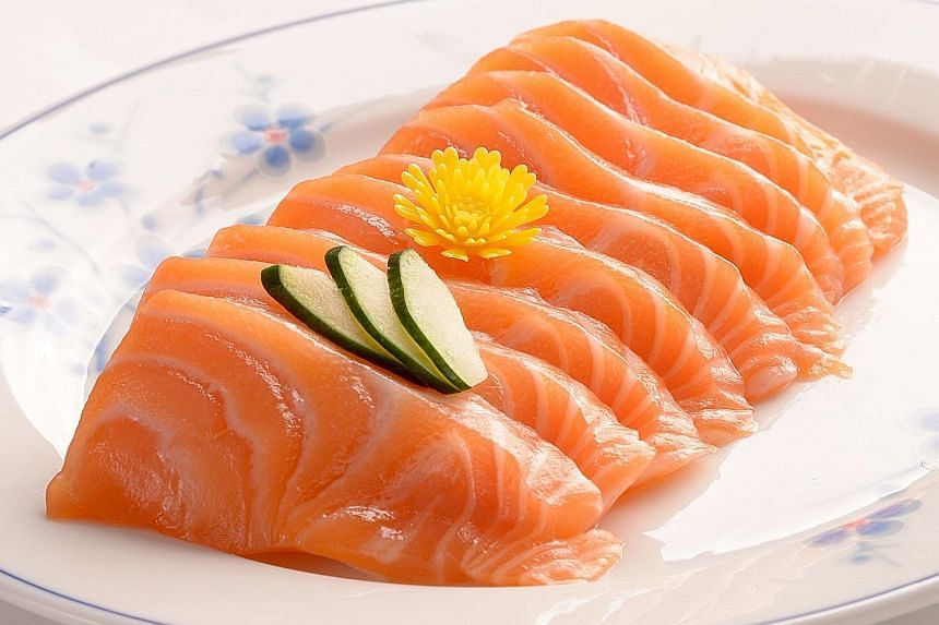 """The ministry found no links between GBS infection and consumption of sashimi (left). Its probe found only an association between the disease and eating """"yusheng-style"""" raw fish sold at food stalls (right)."""