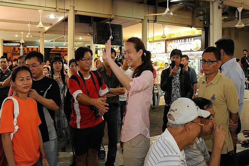 Ms Nicole Seah on the campaign trail in the 2011 election. She has told netizens that she would definitely return to Singapore from Bangkok to help out in the coming polls, but has ruled out being a candidate.