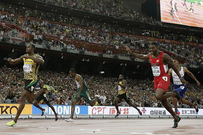 A TV cameraman on a Segway mows down Usain Bolt, who was celebrating his victory in the men's 200m. Fortunately, he was not injured. The Jamaican (far left) had beaten arch-rival Justin Gatlin (in red) with ease.