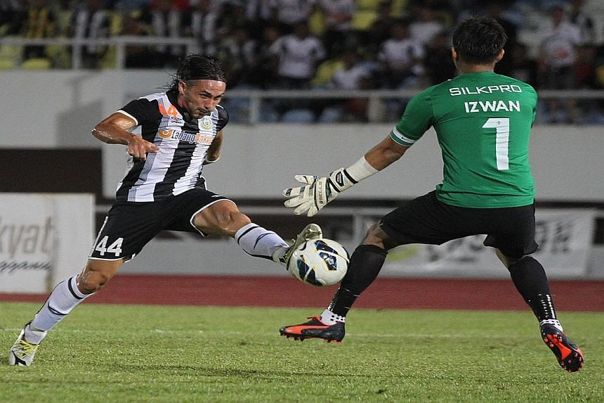 Terengganu's Issey Farran Nakajima scoring against LionsXIl's Izwan Mahbud. The Malaysian side were knocked out of the FA Cup by Fandi Ahmad's men this season and will be out for revenge.