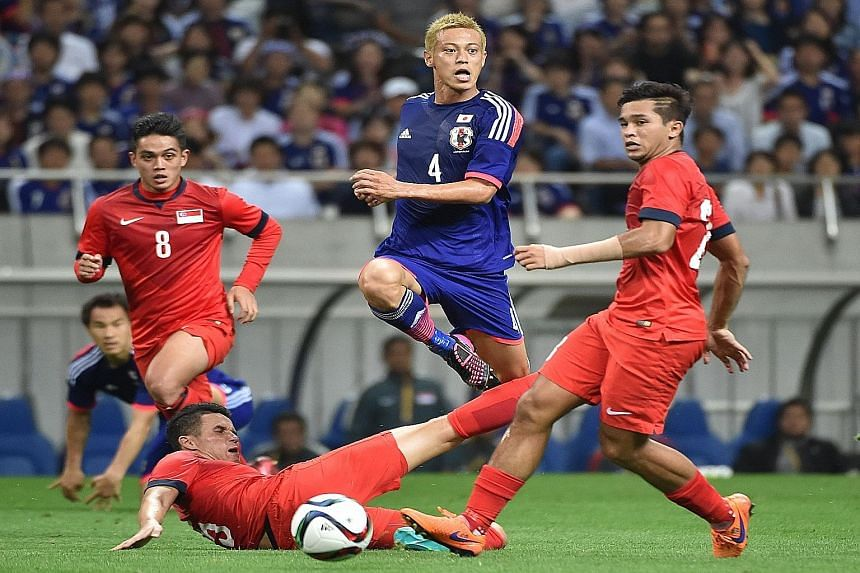 Japan midfielder Keisuke Honda (centre, in blue) launches one of several unsuccessful attacks against Singapore during the dramatic 0-0 draw in the World Cup qualifier in Saitama, Japan on June 16. Head coach Bernd Stange will rely heavily on a simil