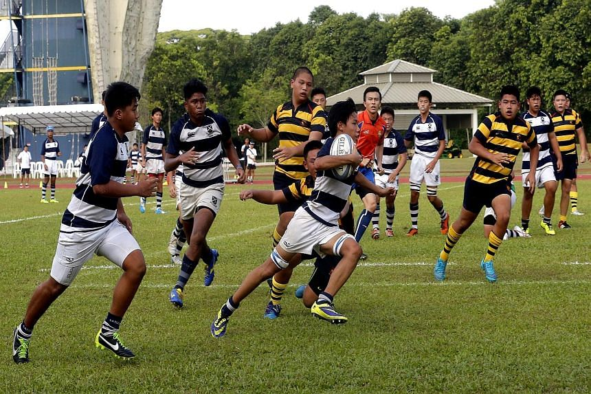 James Leow of St Andrew's sprints clear to score the winning try against ACS(I) in the Schools National C Division rugby final yesterday.