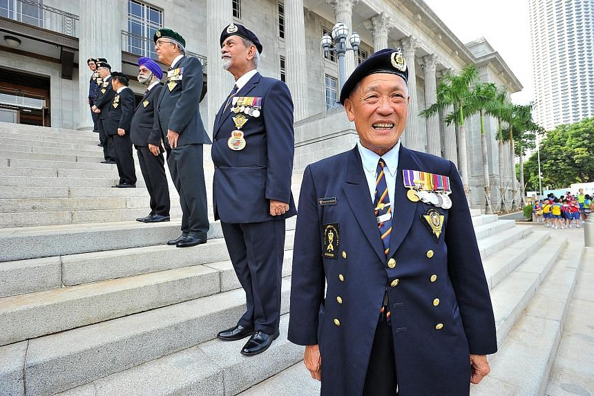 (From front) SWO (Ret) William Wee, 1WO (Ret) Salleh Suratee, Capt (Ret) Hong Seng Mak, members of the SAF Veterans League, on the steps of the National Gallery Singapore yesterday.