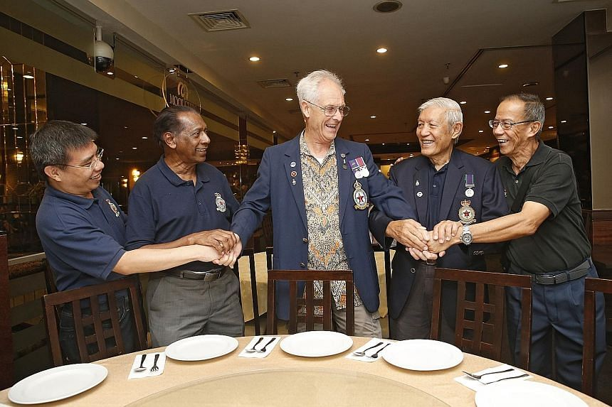 Mr Al Taylor (centre) catching up with (from far left) map researcher Mok Ly Yng and old friends from 81 Squadron - Mr Mohamed Haniffa, Mr Eddie Tan and Mr Derek Yeo.