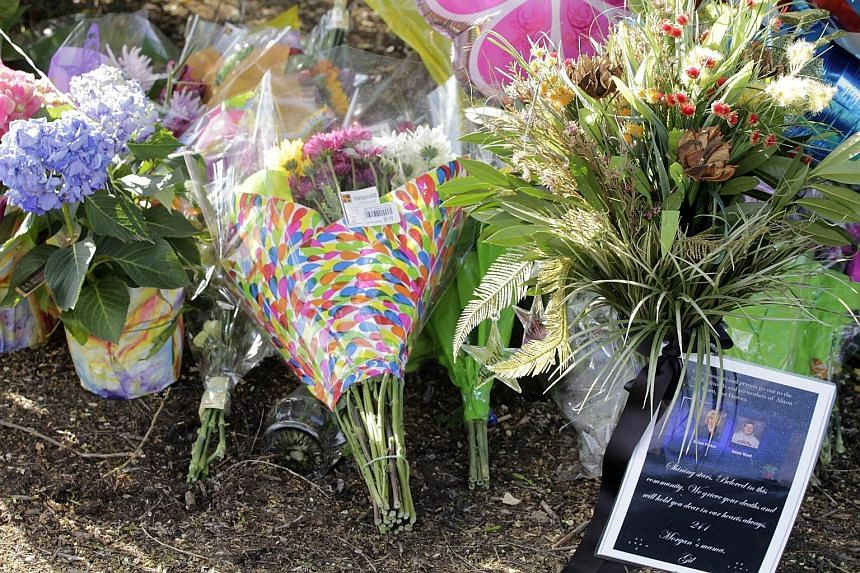 Flowers left by viewers outside WDBJ's gates for reporter Alison Parker and cameraman Adam Ward, who were the early morning reporting duo at the TV station.