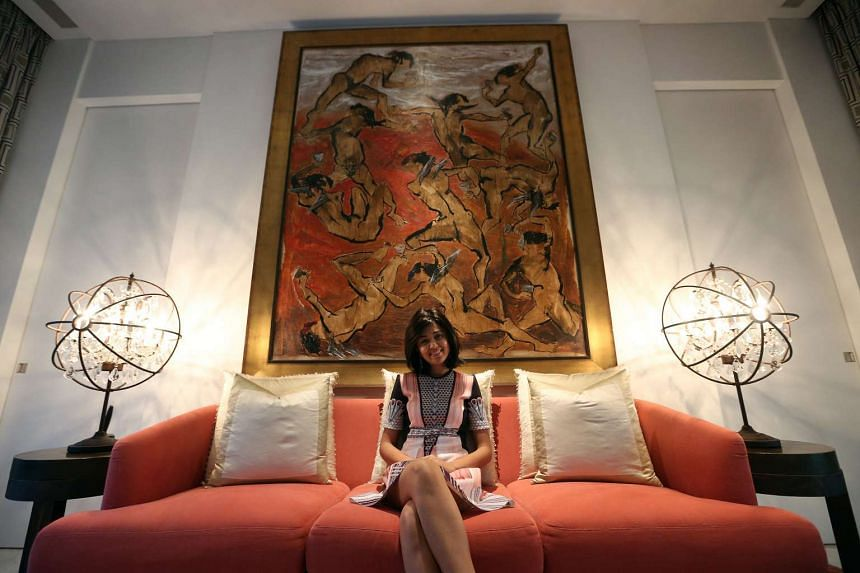 Ms Aarti Lohia with her first buy, Looking For Wings, by Indonesian Putusutawijaya.