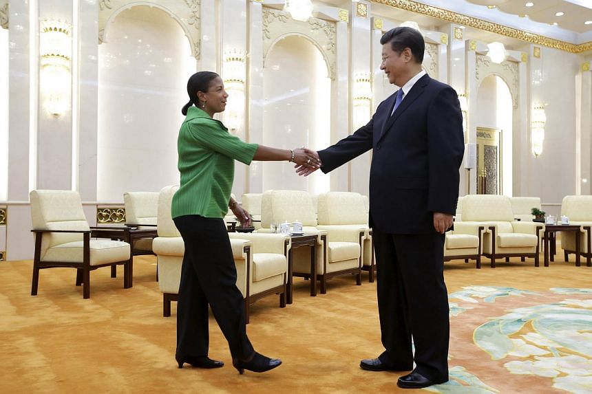 Chinese President Xi Jinping (right) shakes hands with US National Security Advisor Susan Rice at the Great Hall of the People in Beijing, China on Aug 28, 2015.
