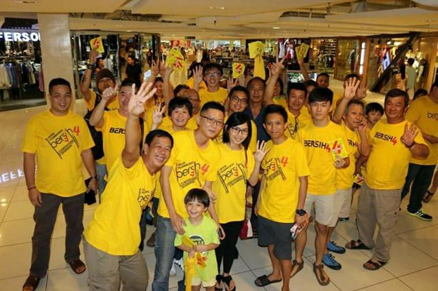 Bersih 4.0 supporters wearing yellow shirts in a shopping mall on Aug 27, 2015.