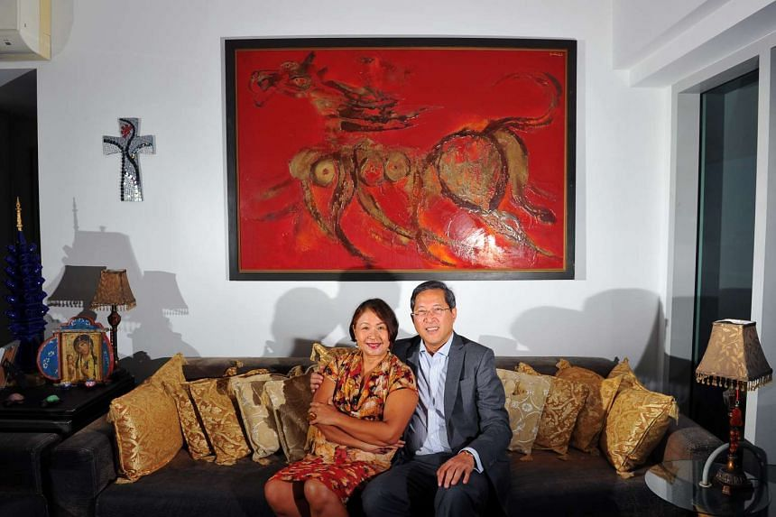 Mrs Kim Camacho and her banker husband Lito Camacho with an untitled painting by Dinh Quan.