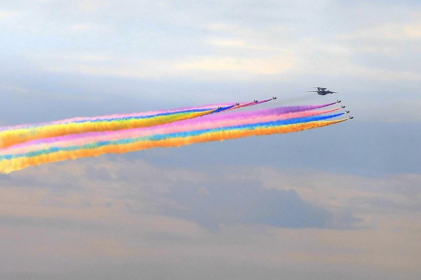 Military aircrafts during a rehearsal ahead of celebrations to mark the 70th anniversary of the end of World War II on Aug 23, 2015.