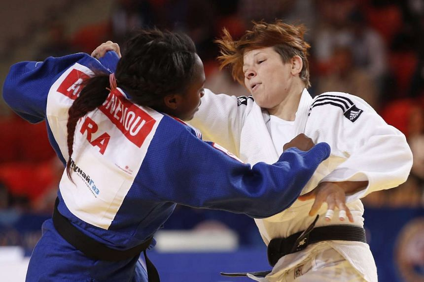 Gold medalist Tina Trstenjak of Slovenia (right) in action against Clarisse Agbegnenou of France during the final bout of the Judo World Championships in Astana, Kazakhstan, Aug 27, 2015.