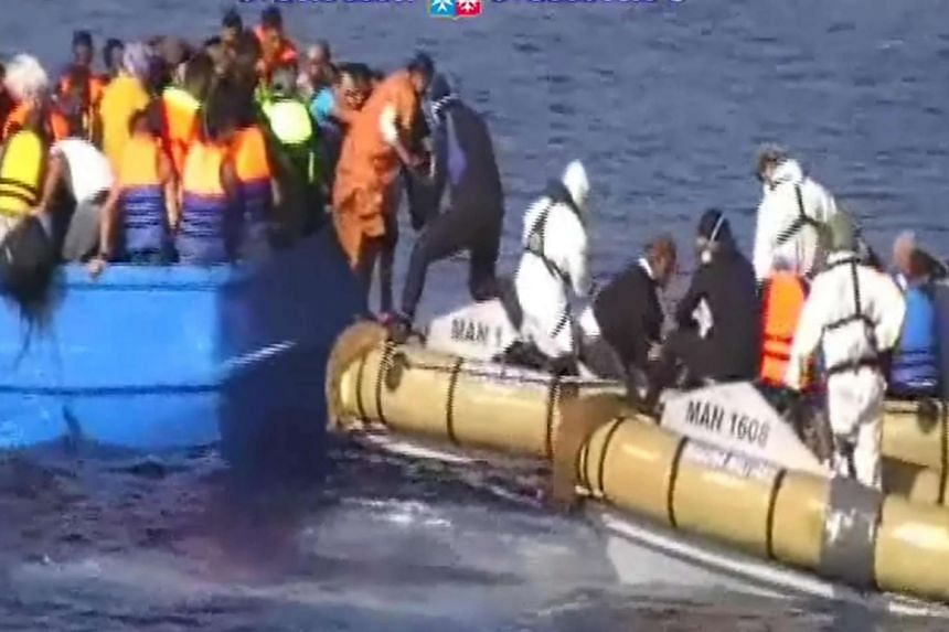 The Italian navy rescuing migrants in the Mediterranean in a navy handout photo.