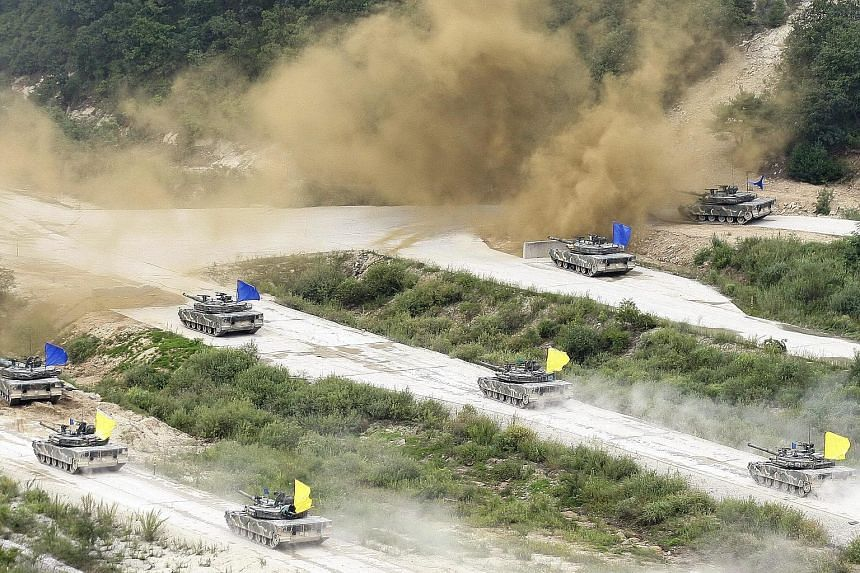 South Korean K1A1 tanks and US M2 Bradley fighting vehicles during a joint life fire exercise on Aug 24, 2015.