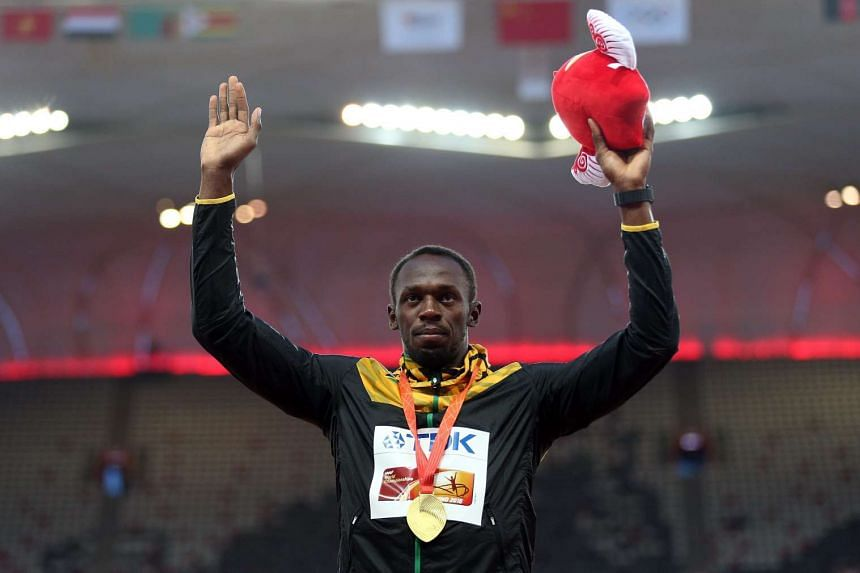 Jamaica's Usain Bolt celebrates on the podium after winning the gold medal in the men's 100m final during the Beijing 2015 IAAF World Championships at the National Stadium, also known as Bird's Nest, in Beijing, China on Aug 24, 2015.