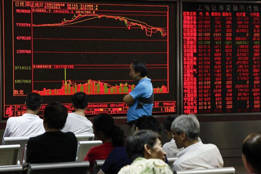 Investors monitor stock market data at a securities brokerage house in Beijing, China on Aug 28, 2015.