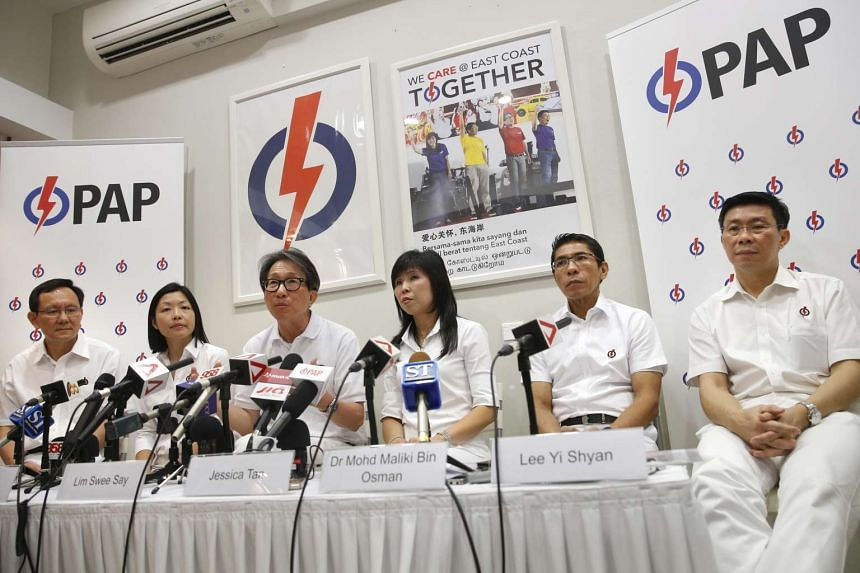 East Coast GRC candidates Lim Swee Say (third from left), Jessica Tan (third from right), Maliki Osman (second from right), and Lee Yi Shyan (right), and Fengshan SMC new face Cheryl Chan (second from left) to contest in place of outgoing Raymond Lim