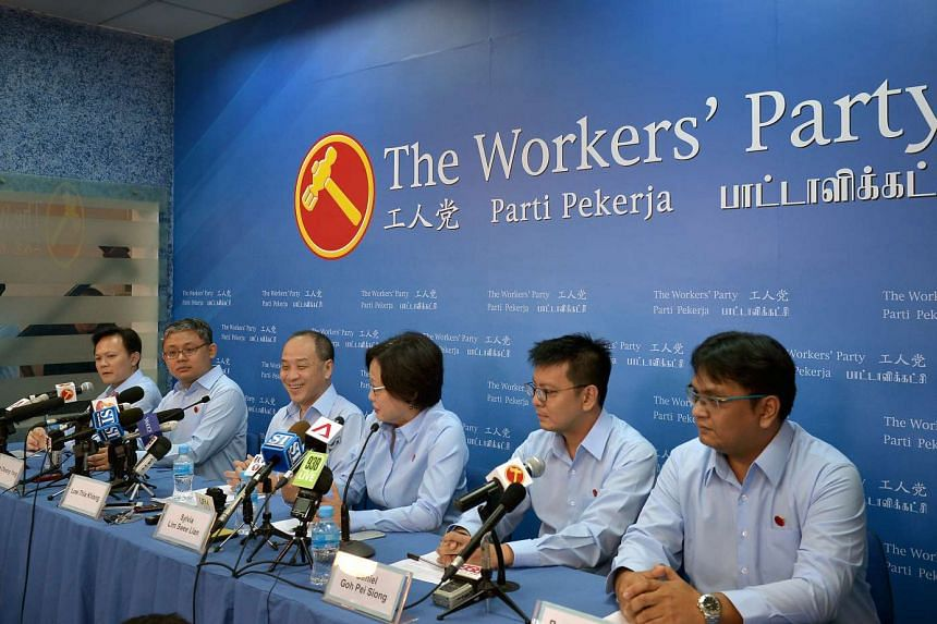 From left to right: Workers' Party (WP) new candidates, Dylan Ng and Koh Choong Yong, WP chief, Mr Low Thia Kiang (third from left), WP chairman Ms Sylvia Lim (fourth from left) and the other two new candidates Daniel Goh (second from right) and Redz