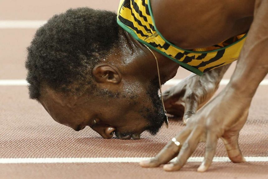 Jamaica's Usain Bolt kissing the track after winning the final of the men's 200m athletics event at the 2015 IAAF World Championships in Beijing on Aug 27, 2015.