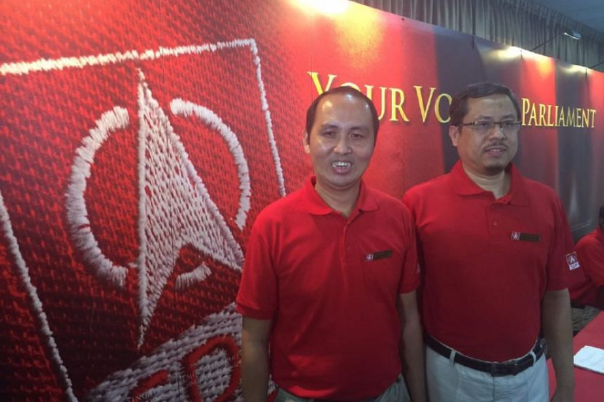 SDP candidates Bryan Lim (left) and Damanhuri Abas.