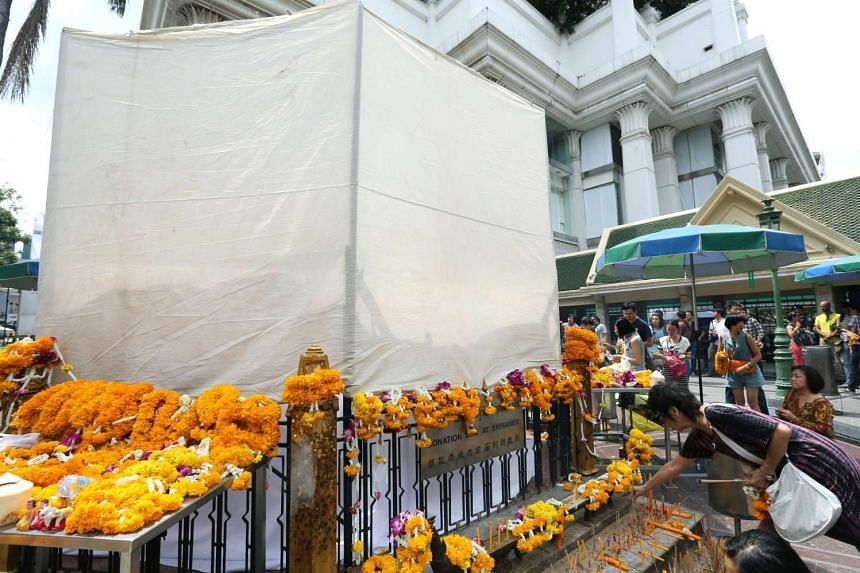 A tent is seen around the Erawan shrine on Aug 26 as Thai craftsmen carry out repairs on the statue of Lord Brahma, the Hindu God of creation, which was damaged in the Aug 17, 2015, bomb attack on Aug 17, 2015.